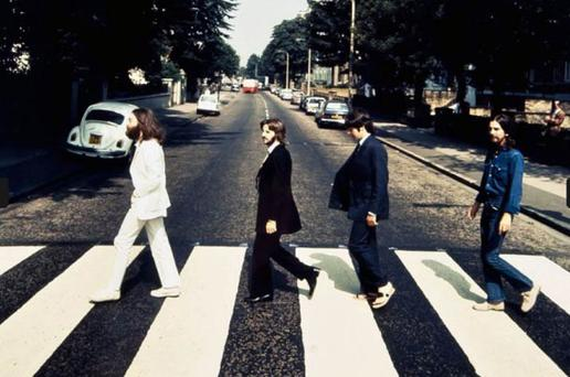 The Beatles walking the opposite way over the Abbey Road zebra-crossing with Paul McCartney wearing a pair of leather flip-flops