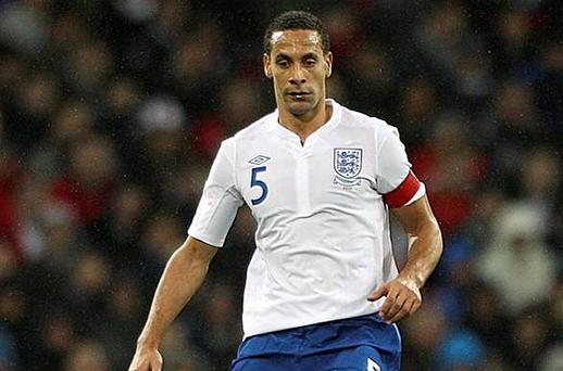Rio Ferdinand in action for England. Photo: PA