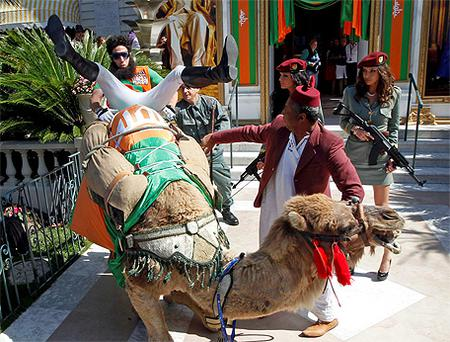 British actor Sacha Baron Cohen causes chaos with a camel on the famous Croisette promenade in Cannes