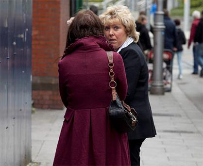 Catherine Kelly (right): outside court in Dublin yesterday