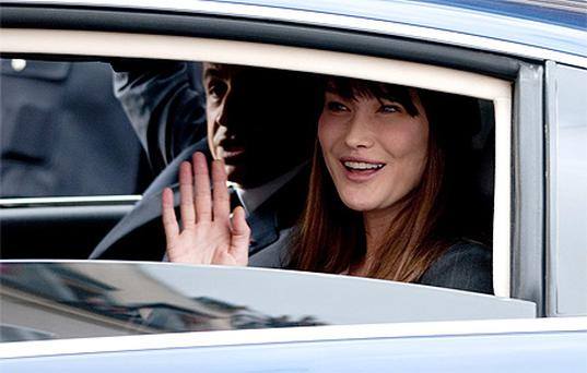 Nicolas Sarkozy and Carla Bruni leave the Elysee Palace after Francois Hollande was sworn in as President