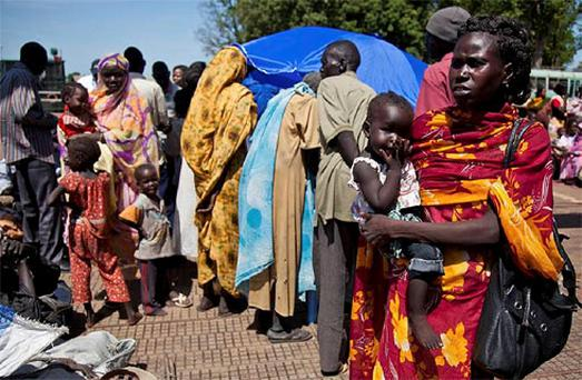 South Sudanese returnees from Khartoum gather at the port in South Sudan's capital Juba. Photo: Reuters