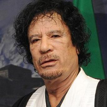 The doctor who later carried out the post-mortem examination on 69-year-old Gaddafi was threatened with death in order to keep his findings quiet, it says