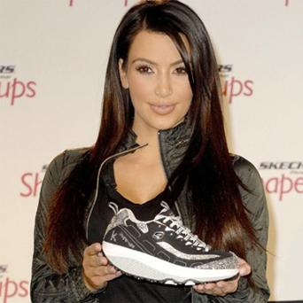 Kim Kardashian promoting Skechers Shape-Up trainers