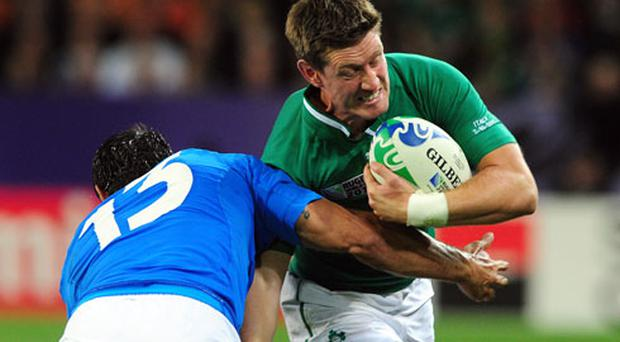 Ireland's fly-half Ronan O'Gara (R) vies with Italy's center Gonzalo Canale during the 2011 Rugby World Cup pool C match Ireland vs Italy at the Otago Stadium in Dunedin. Photo: Getty Images