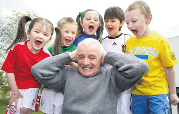 RTE soccer pundit Eamon Dunphy shields his ears from Robyn Dempsey (5), from Kilcullen, Co Kildare, Callum Heath (4), Tallaght, Dublin, Susie Power (8), Kilcullen, Rowan Durmis (6), of Citywest, Dublin, and Liam Hyland (5), from Greenhills, at the launch of RTE's Euro 2012 coverage.
