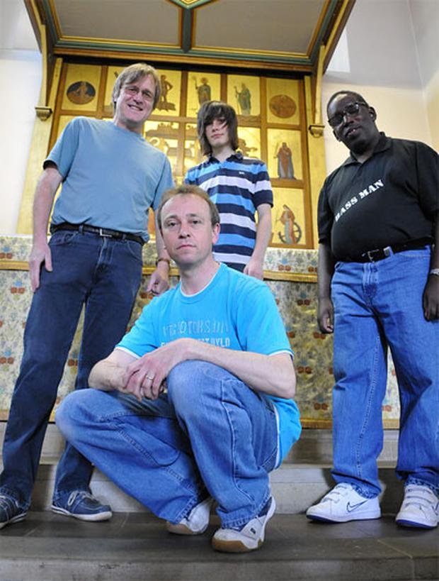 Rev Nick Cook (center) will conduct a 'U2charist' at his church in Leicestershire tomorrow.