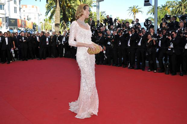 Eva Herzigova works the red carpet in Cannes wearing Chopard jewellery and Dolce & Gabbana gown.