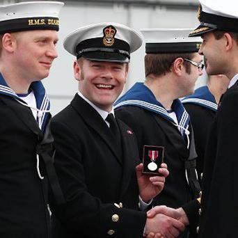 Chief Petty Officer Brian Diamond, who serves on HMS Diamond, receives the Queen's Diamond Jubilee medal