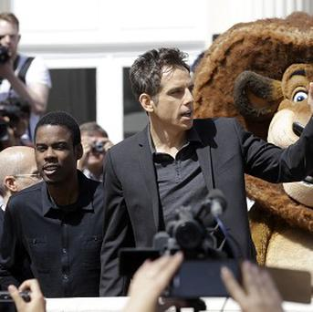 Actors Chris Rock, left and Ben Stiller wave to fans during a photo call for Madagascar 3 during the 65th international film festival, in Cannes (AP Photo/Lionel Cironneau)