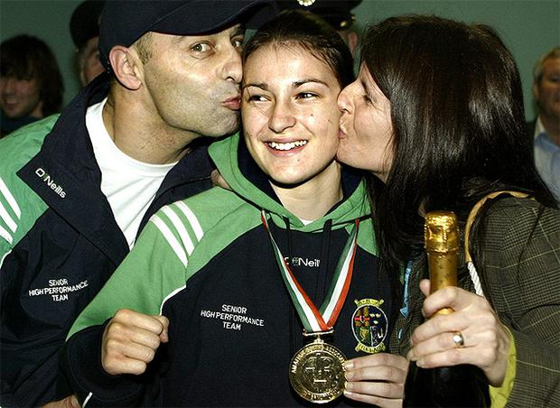 Katie Taylor gets a big hug and kiss from her parents Peter and Bridget in Dublin Airport