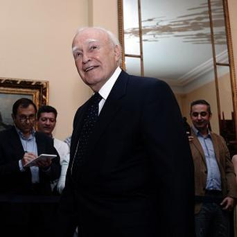 Greek president Karolos Papoulias has appointed a senior judge as interim prime minister (AP)