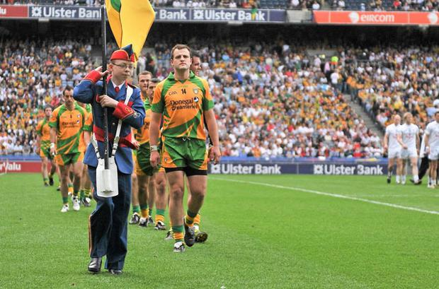 Michael Murphy leads his Donegal team-mates in the parade before last year's win over Kildare – it will be interesting to see how they cope without the injured star against Cavan tomorrow