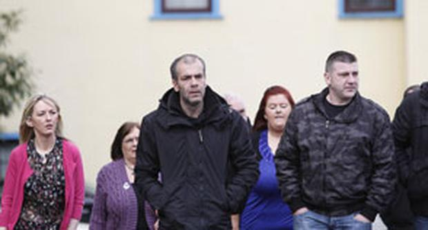 Colin Duffy (centre) outside Lisburn courthouse in Northern Ireland as Paul Duffy, Shane Duffy and Damien Duffy appeared on charges including conspiracy to murder, collecting information likely to be of use to terrorists, planning acts of terrorism and conspiring to cause an explosion.