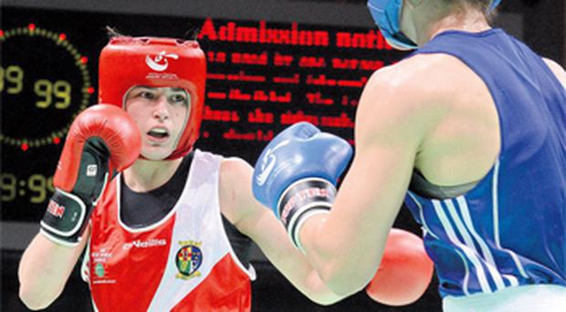 Katie Taylor exchanges punches with Sofya Ochigava during yesterday's Lightweight 60kg world final. Photo: David Maher