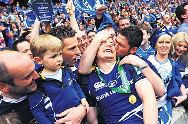 Fans mob Brian O'Driscoll on the pitch after victory