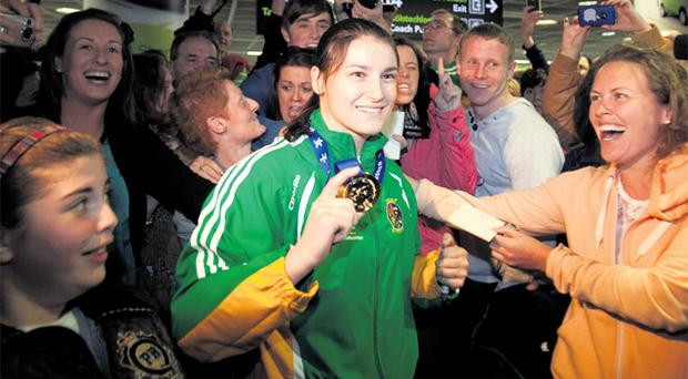 Boxer Katie Taylor arrives at Dublin Airport yesterday after winning her fourth successive world championship in China