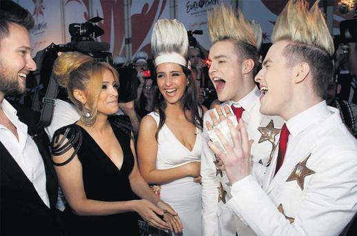 Jedward meet last year's winners Ell and Nikki (left) and show presenter Nargiz (centre) at the welcome party in the Euroclub in Baku, Azerbaijan