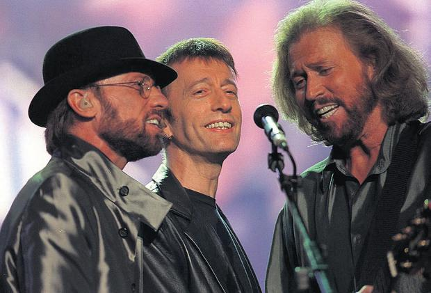 Maurice, Robin and Barry Gibb. The brothers wrote 23 number one records and were the only song writers to have number ones in the last five decades