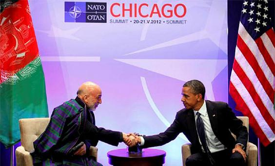U.S. President Barack Obama hosts a meeting with Afghanistan's President Hamid Karzai during the NATO Summit at McCormick Place in Chicago. Photo: Reuters