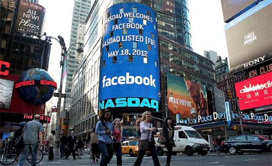 A monitor shows a welcoming message for Facebook's listing on the NASDAQ Marketsite prior to the opening bell in New York May 18, 2012. Photo: Reuters