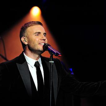 Gary Barlow remained tight-lipped about who would be performing on the roof at the event