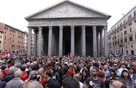 People gather during a demonstration of solidarity in front of Rome's Pantheon for the victims of the explosive device that went off near the