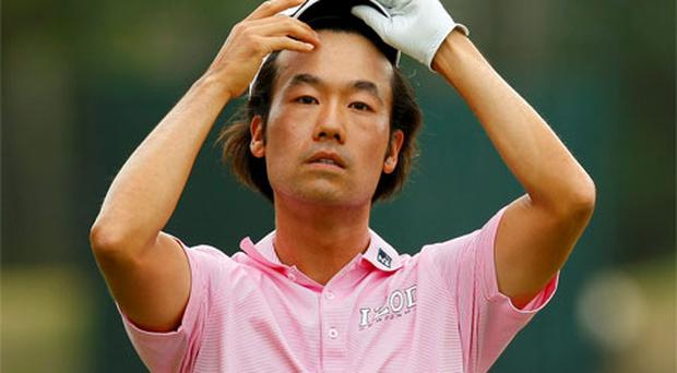 Kevin Na of the U.S. reacts after hitting his approach shot on the seventh hole during the final round of the Players Championship PGA golf tournament at TPC Sawgrass in Ponte Vedra Beach, Florida. Photo: Reuters