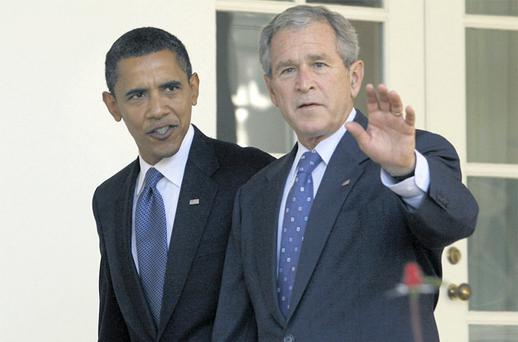 Barack Obama with his predecessor George W Bush: 'a fitting symbol of a diverse America'.