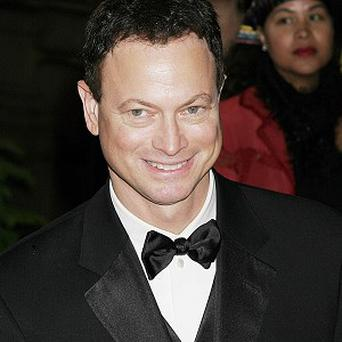 Gary Sinise's band will perform to raise money for an injured Marine
