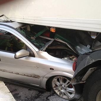 A driver walked away with just minor injuries after his vehicle became trapped under the side of the lorry (West Midlands Ambulance Service /PA)