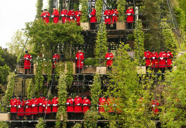 Chelsea Pensioners open the Westland Magical Tower Garden, a 24 meter high seven-tiered garden display, at the RHS Chelsea Flower Show, in Chelsea, west London. PRESS ASSOCIATION Photo. Picture date: Monday May 21, 2012. See PA story CONSUMER Chelsea. Photo credit should read: Dominic Lipinski/PA Wire