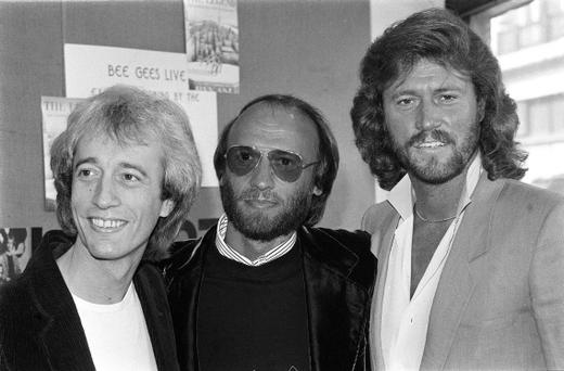File picture, dated 18/10/1983, The Bee Gees pop group (from left) brothers Robin, Maurice and Barry Gibb. PRESS ASSOCIATION Photo. Issue date: Sunday May 20, 2012. Robin Gibb, who has died, aged 62, his twin brother Maurice, who died in 2003, and elder brother Barry Gibb notched up dozens of hits - as performers and writers - and sold more than 200 million records. See PA story DEATH Gibb. Photo credit should read:/PA Wire