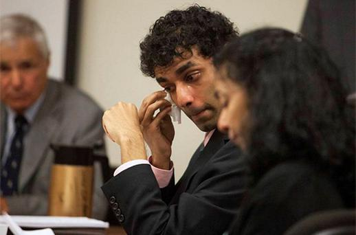 Dharun Ravi wipes a tear from his eye as his mother, Sabitha Rav reads a statement during a sentencing hearing for his conviction in using a webcam to invade privacy