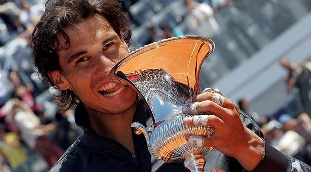 Rafael Nadal poses with the trophy after winning his men's singles final match against Novak Djokovic at the Rome Masters. Photo: Reuters