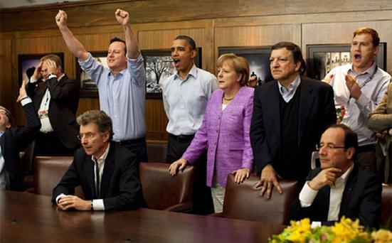 British Prime Minister David Cameron cheers as he and other world leaders watch the the Chelsea vs Bayern Munich Champions League final during the G8 Summit at Camp David, Maryland.