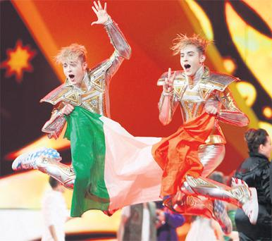Jedward jump for joy after securing their place in Saturday's grand final of Eurovision