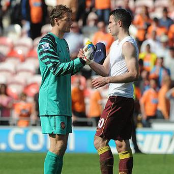 Jens Lehmann (left) and Robin van Persie