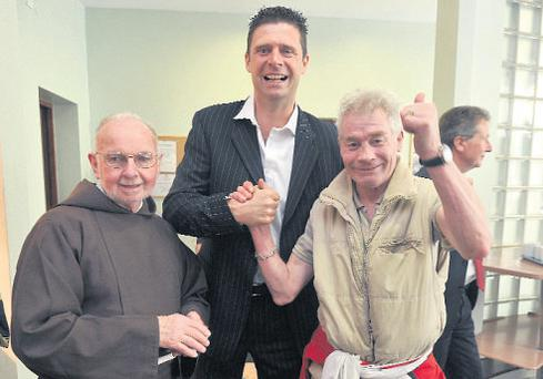 Niall Quinn with Brother Kevin Crowley and John Bambrick at the Capuchin Day Centre in Dublin. Photo: Damien Eagers