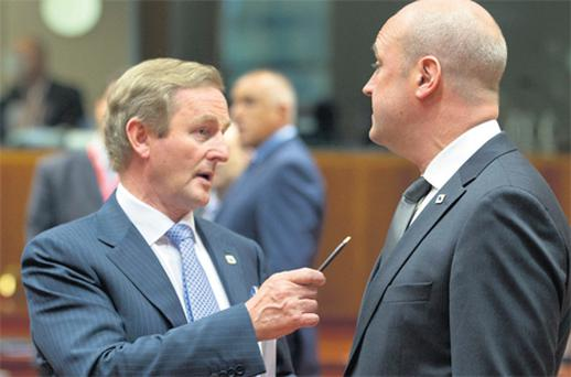 Taoiseach Enda Kenny with Fredrik Reinfeldt, prime minister of Sweden, at the European Council HQ in Brussels yesterday