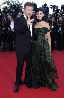 Actor Alec Baldwin, left, and Hilaria Thomas arrive for the screening of Killing Them Softly at the 65th international film festival, in Cannes, southern France, Tuesday, May 22, 2012. (AP Photo/Joel Ryan)