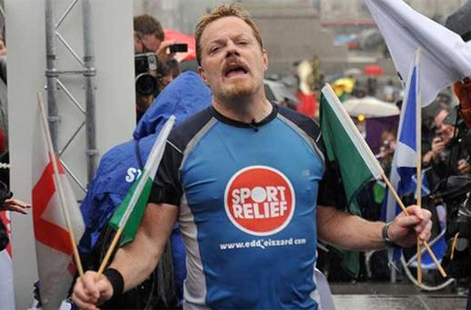 'These heels are killing me!' Eddie Izzard reaches the finish line after completing his 1,100mile run around the UK in support of Sport Relief Photo: PA