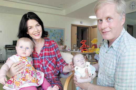 Catherine and John McWade from Stillorgan, Dublin, with their six-month-old twins Molly and Leo. Leo was born with a heart defect