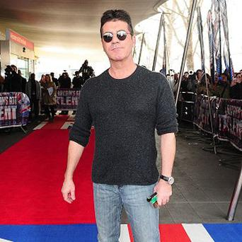 Simon Cowell has hinted that he would like to pick future Eurovision entries