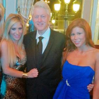 Bill Clinton posed with pornographic actress Brooklyn Lee (right) and her colleague Tasha Reign