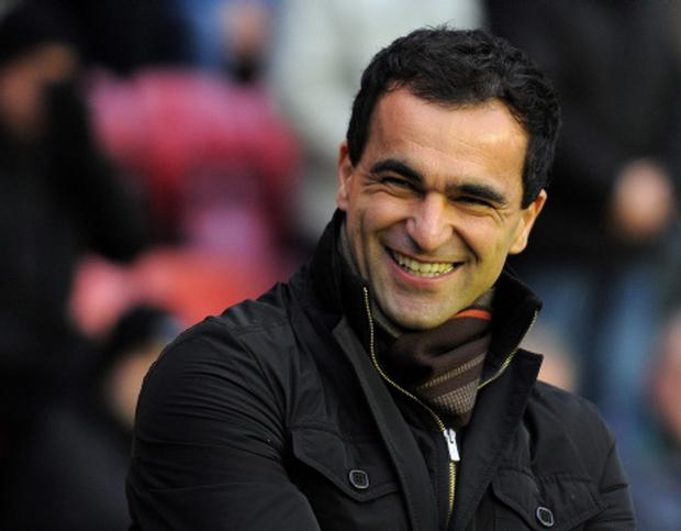 WIGAN, ENGLAND - JANUARY 15: (FILE PHOTO) Wigan manager Roberto Martinez laughs before the Premier League match between Wigan Athletic and Fulham at the DW Stadium on January 15, 2011 in Wigan, England. Wigan owner Dave Whelan has granted Liverpool permission to speak with their manager following the Merseyside club's sacking of Kenny Dalglish. (Photo by Michael Regan/Getty Images)