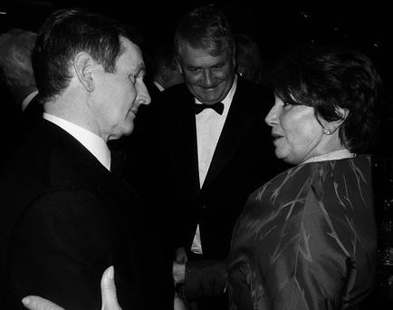 TALK: Taoiseach Enda Kenny, left, greeting US House of Representatives minority leader Nancy Pelosi, right, with Denis O'Brien, at the American Ireland Fund's annual national gala in Washington on March 20, 2012