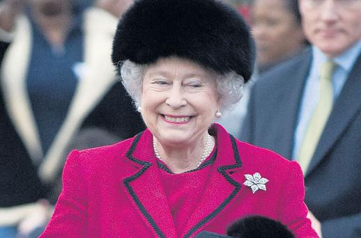 HAPPY REIGN: Queen Elizabeth, on one of her many official engagements