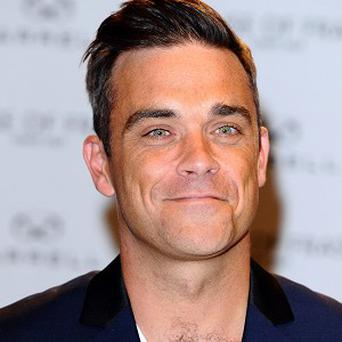 Robbie Williams is set to become a dad for the first time