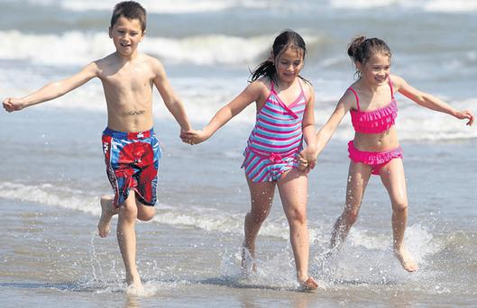 Raul Harfas (7), Alexandra Pope (8) and Sabrina Harfas (9) enjoyed the sun yesterday on Portmarnock Beach